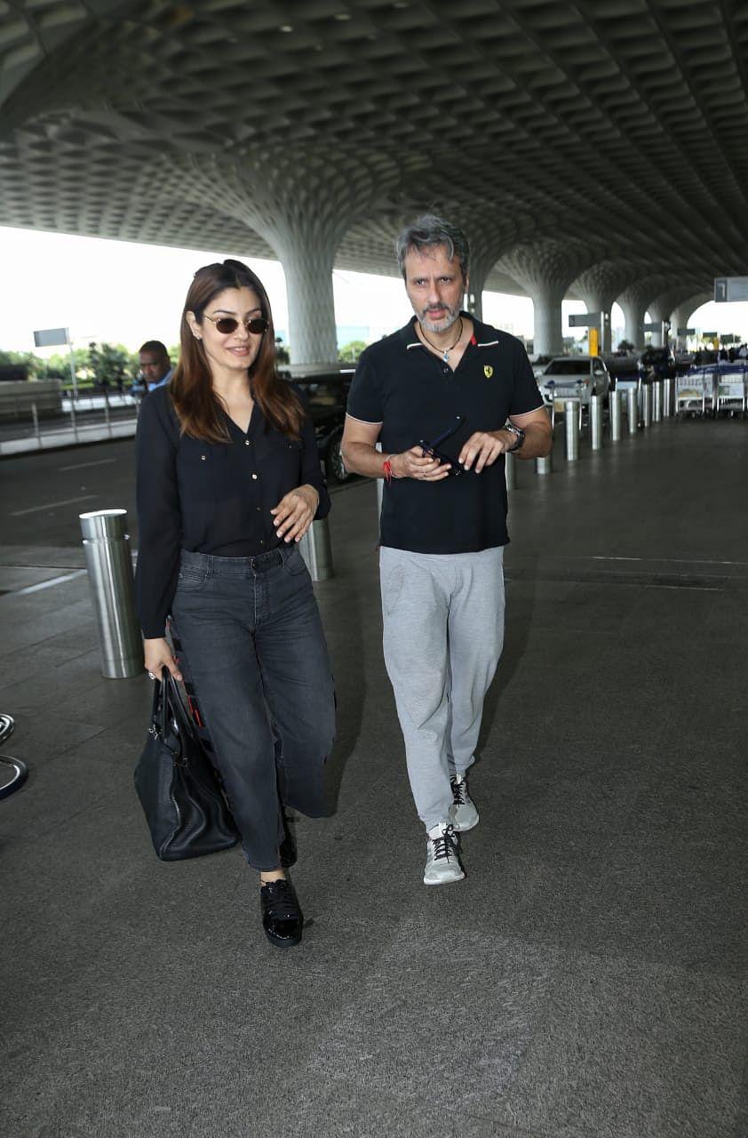 Raveena Tondon with husband at Mumbai airport