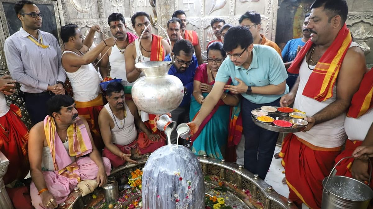 Collector offering milk to Mahakal
