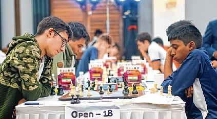 GM Praggnanandhaa (R), playing black, against Iran's Aryan Gholami