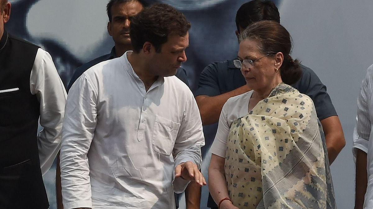 Indian Congress Party President Sonia Gandhi (R) stands with her son Rahul Gandhi in New Delhi