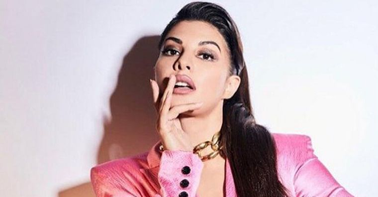 Jacqueline Fernandez is giving us sexy boss lady vibes in a pink pantsuit