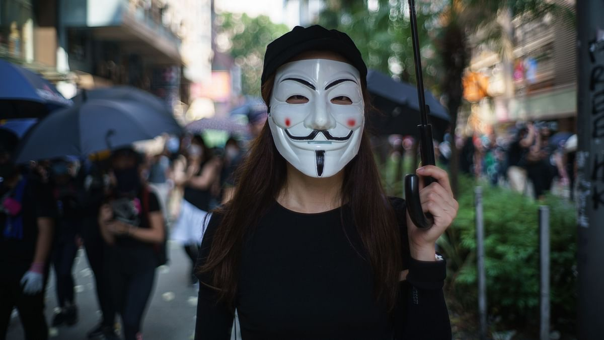 A protester wearing a Guy Fawkes mask during a standoff with police in Hong Kong.