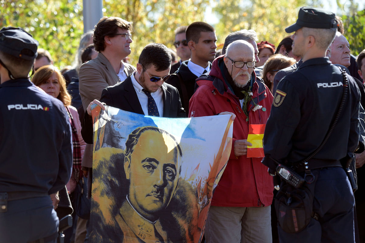 Spain reburies Francisco Franco's body in discreet tomb