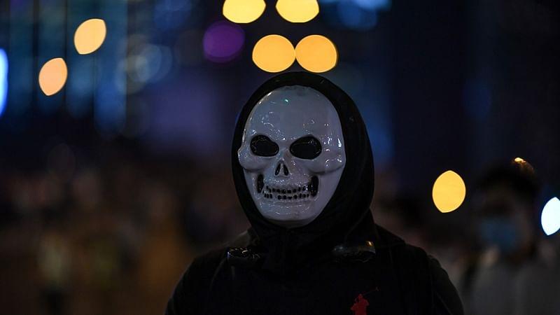 Thousands protest mask ban as Hong Kong leader toughens stance