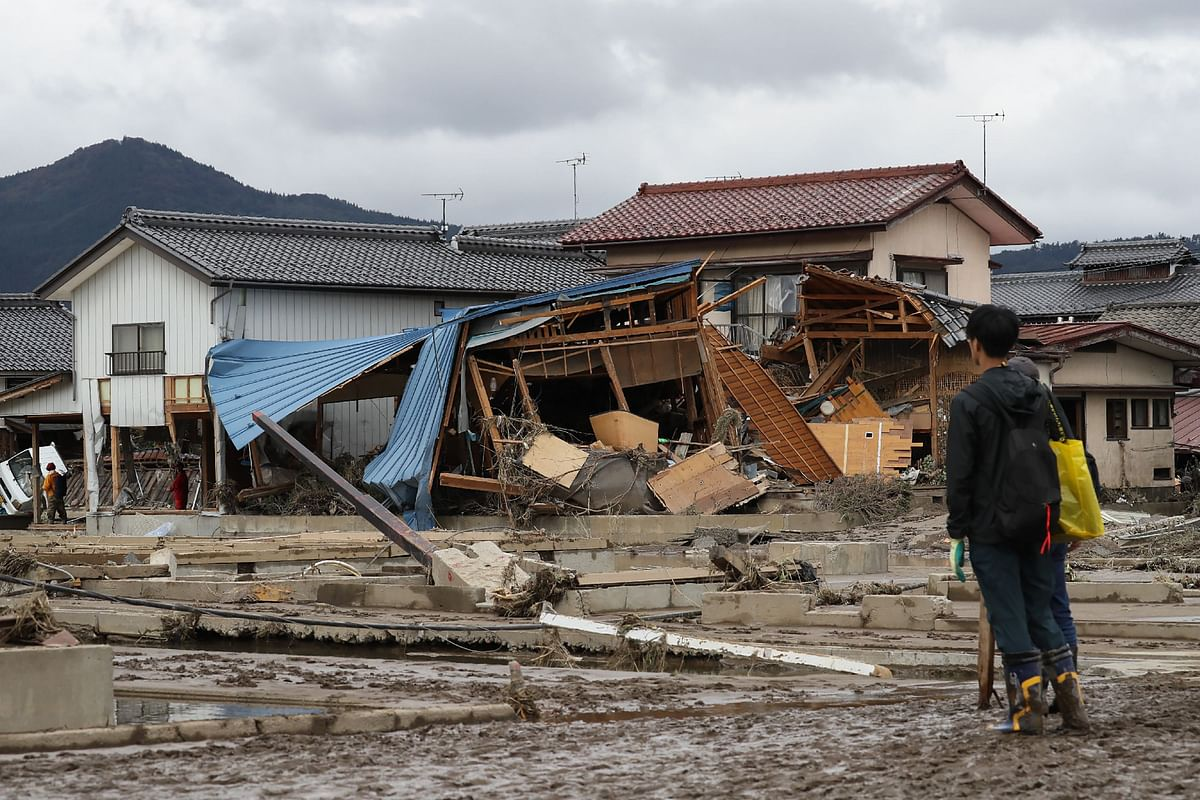Japan PM Shinzo Abe promises action after homeless denied typhoon refuge