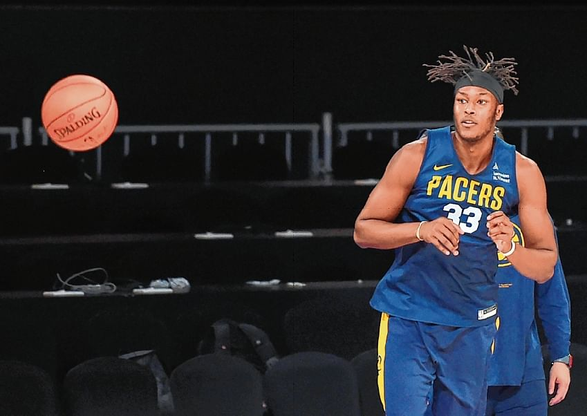 Indiana Pacers player Myles Turner takes a shot during a training session at the NSCI Dome in Mumbai on Thursday