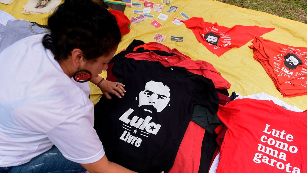 Street vendors offers jerseys and other merchandise of former Brazilian President Luiz Inacio Lula da Silva, in the surroundings of the Federal Police Headquarters where the ex-president is serving prison, in Curitiba, Parana State, Brazil, on November 8, 2019.
