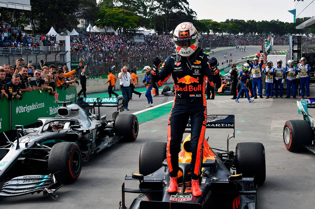 Red Bull's Dutch driver Max Verstappen celebrates after winning the F1 Brazil Grand Prix, at the Interlagos racetrack in Sao Paulo, Brazil.