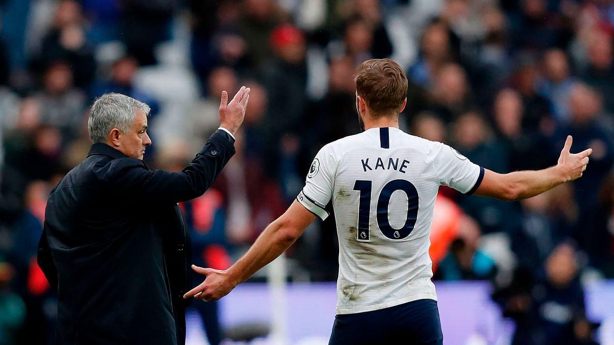 Jose Mourinho (L) with Harry Kane