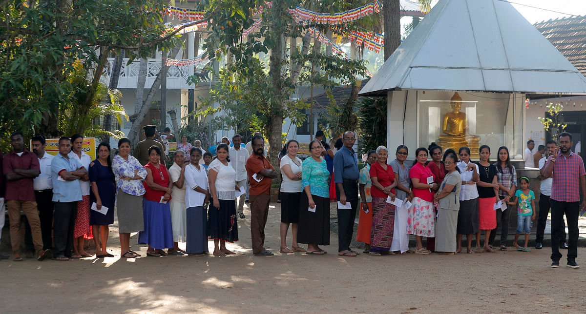 Sri Lankans wait in queue to cast their votes at a polling station during the presidential election in Colombo, Sri Lanka, Saturday, Nov. 16, 2019.