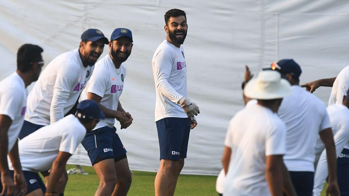 Skipper Virat Kohli jokes with teammates during a net  session at Eden Garden on Wednesday.