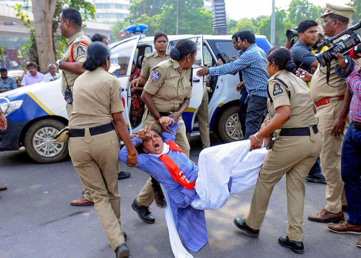 Police personnel detain a protestor during a demonstration, in Hyderabad, Saturday, Nov. 9, 2019.