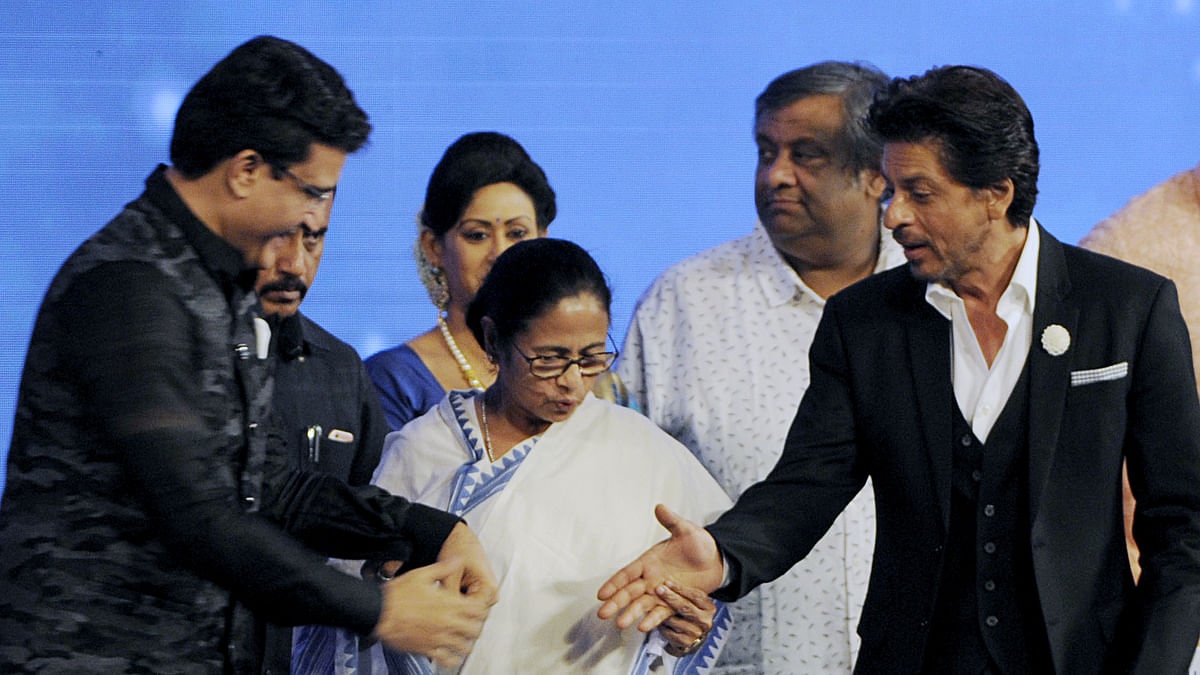 BCCI president Sourav Ganguly (left)  with West Bengal Chief Minister Mamta Banerjee (center) greeted by Bollywood Actor Shahrukh Khan.