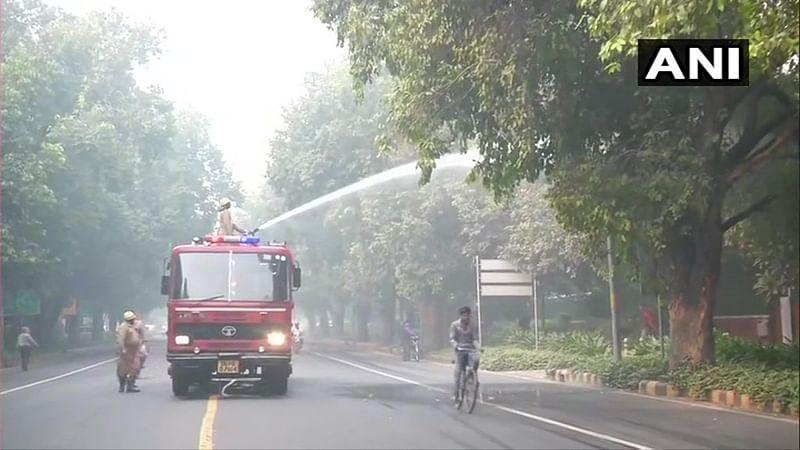Delhi: NDMC Trucks sprinkle water on Lodhi road to settle dust amid rising AQI
