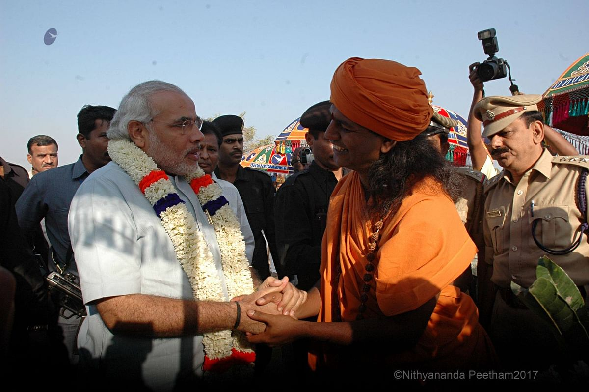 After Nithyananda skips country, pictures of him meeting Modi go viral