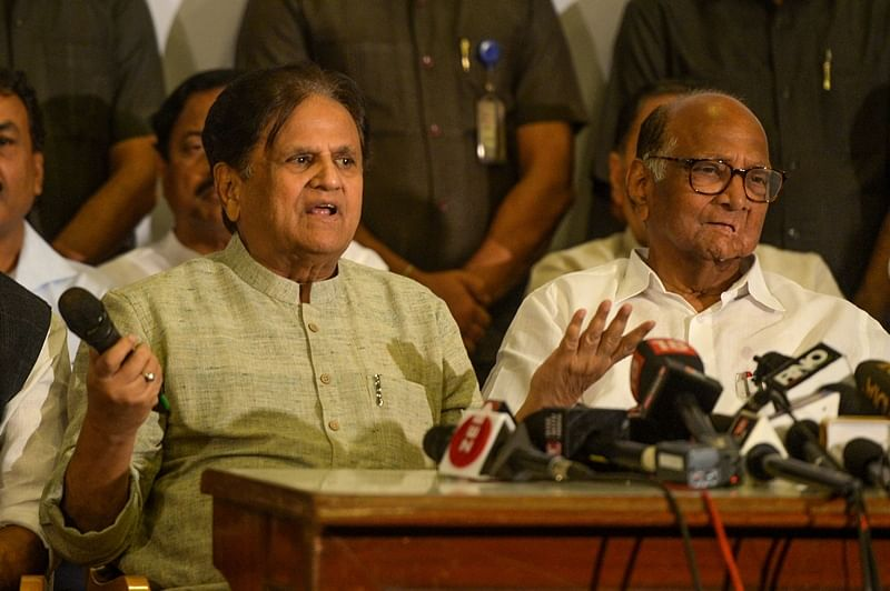 National Congress party general secretary Ahmed Patel (L) speaks as party president Sharad Pawar (R) looks on during a press conference in Mumbai on November 12, 2019. (Photo by Punit PARANJPE / AFP)