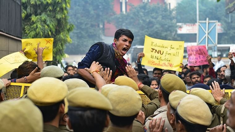 Police stop JNU students who were staging a protest over the hostel fee hike outside the UGC office at ITO in New Delhi on Nov 13, 2019.