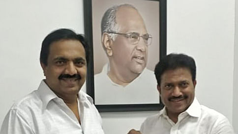 NCP MLA Shashikant Shinde being appointed as Vice President of party's Maharashtra unit by Maharashtra NCP chief Jayant Patil, in Mumbai on Friday.