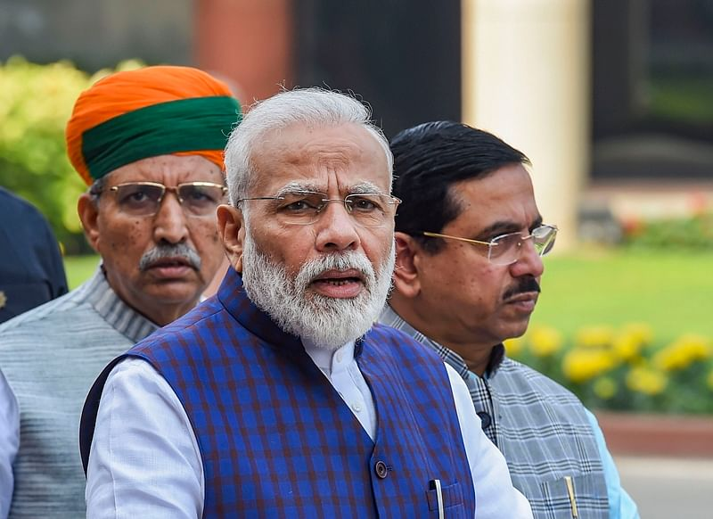 New Delhi: Prime Minister Narendra Modi addresses the media on the first day of the Winter Session of Parliament, in New Delhi, Monday,  Nov. 18, 2019. MoS Parliamentary Affairs Minister Arjun Ram Meghwal and Minister for Parliamentary Affairs, Coal and Mines Pralhad Joshi are also seen. (PTI Photo/Atul Yadav)(PTI11_18_2019_000023B)