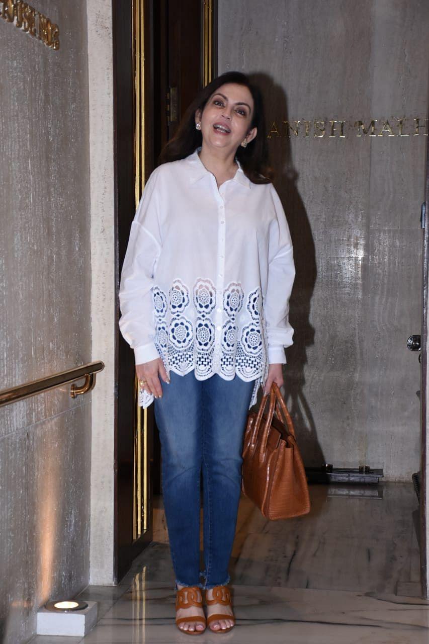 Nita Ambani keeps it simple yet stylish in a chic white shirt and blue jeans