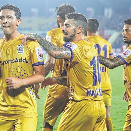 NorthEast United FC players celebrate after equalising against Mumbai City