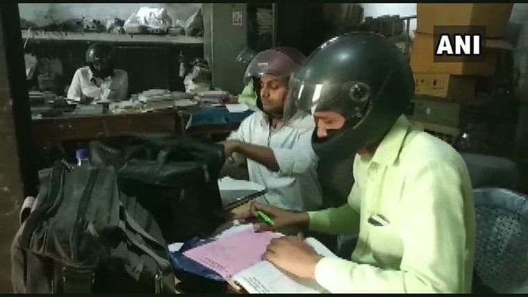 'In case any mishap takes place': UP govt employees wear helmets, work in building with holes in roof