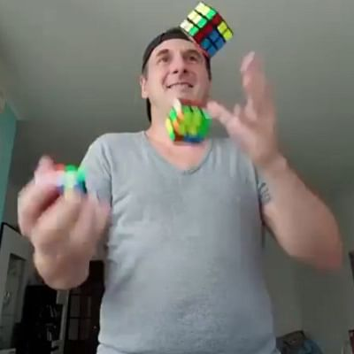 Watch: Did this juggler solve 3 Rubik cubes while juggling them?