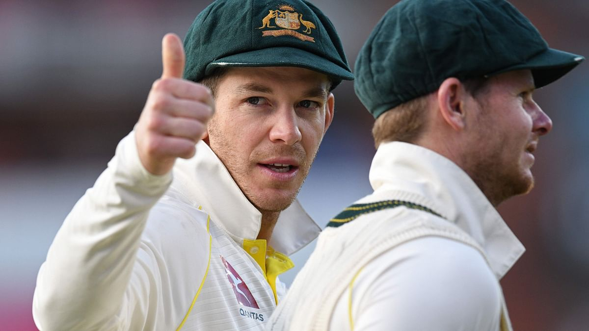 Australia captain Tim Paine (L) with Steve Smith