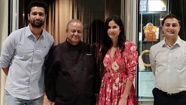 Katrina Kaif with Vicky Kaushal, hotel chef and a staff member.