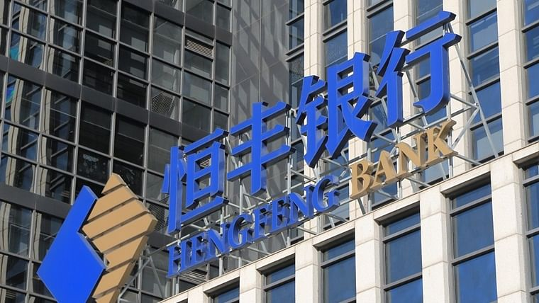 Dragon falters: Another bank collapses as China's economic growth slows to 30-year low