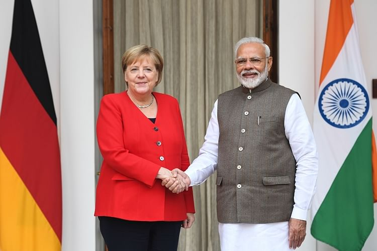 India's Prime Minister Narendra Modi (R) shakes hands with German Chancellor Angela Merkel before a meeting at Hyderabad House in New Delhi in 2019. (File)