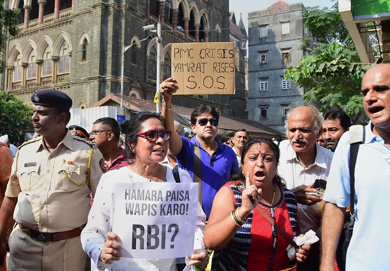 Mumbai: PMC account holders protest outside High Court premises over the bank's crisis, in Mumbai, Tuesday, Nov. 19, 2019. (PTI Photo) (PTI11_19_2019_000184B)
