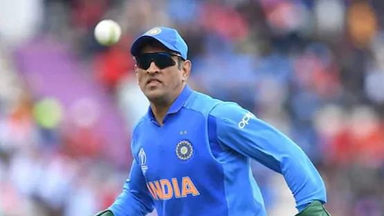 Former India captain MS Dhoni running to collect a throw.