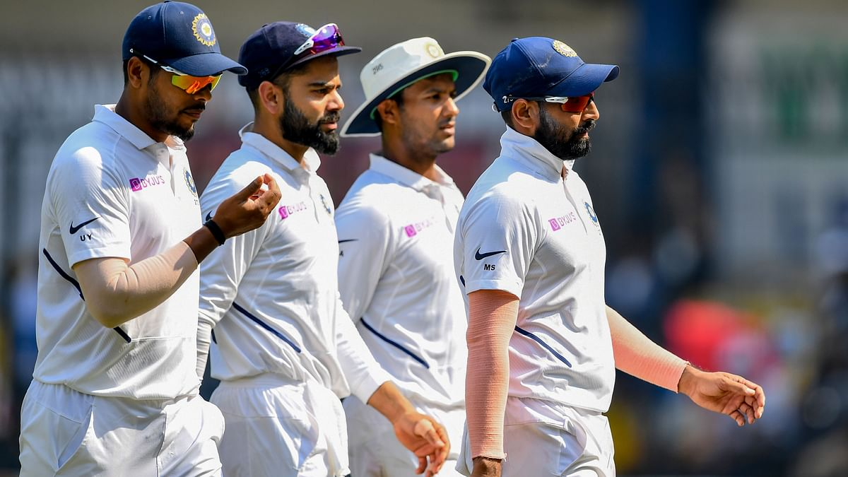 (L-R) India's Umesh Yadav, captain Virat Kohli, Mayank Agarwal and Mohammed Shami walk to the pavilion for lunch during the third day of the first Test cricket match of a two-match series between India and Bangladesh at Holkar Cricket Stadium in Indore on November 16, 2019.