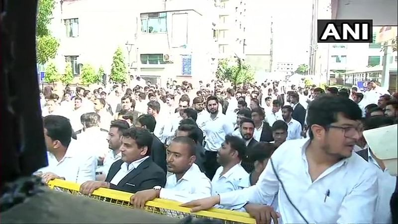 Cops vs Lawyers: Angry advocates protest FIR, continue to boycott work