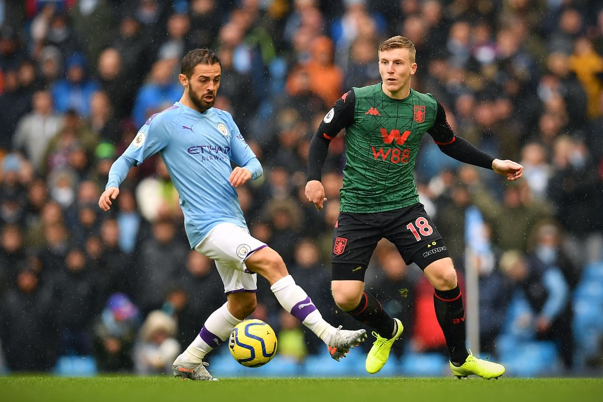 Bernardo Silva (blue) the striker in focus for City
