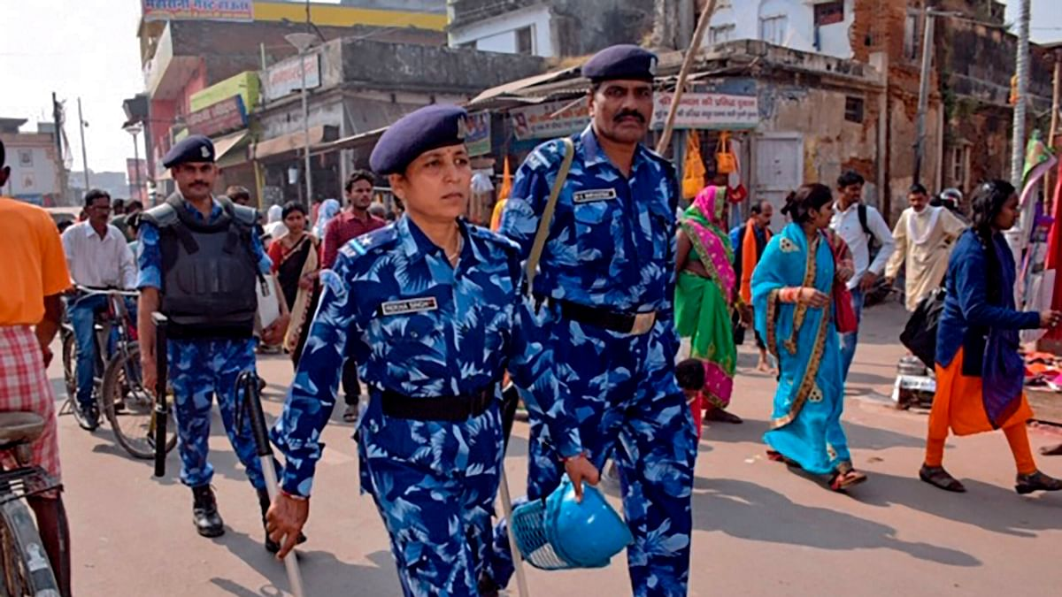 Rapid Action Force (RPF) personnel patrol on a street in Ayodhya on November 8, 2019, ahead of a Supreme Court verdict on the future of a disputed religious site.