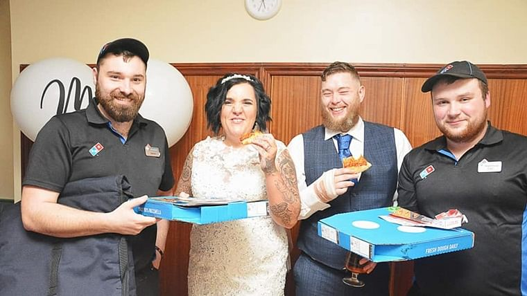 UK couple order Domino's pizza and chicken strips for their wedding meal after they 'couldn't decide on menu'