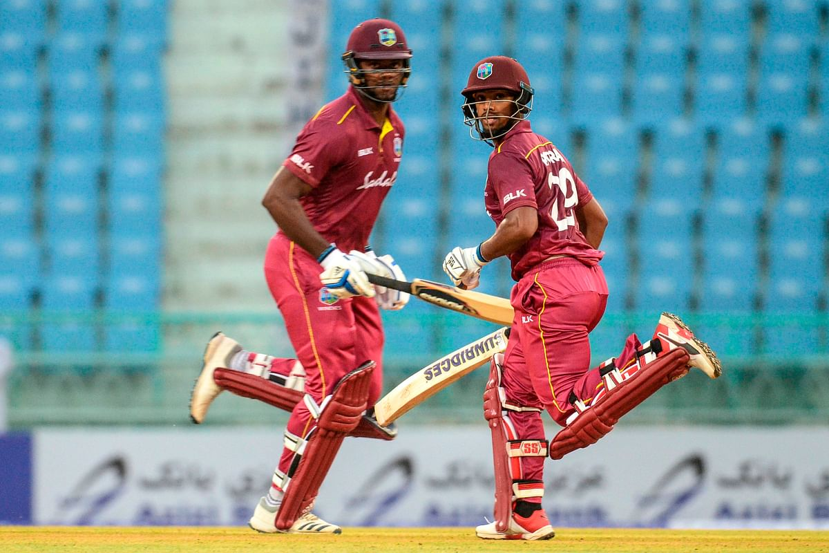 West Indies' Nicholas Pooran (R) and Romario Shepherd (L) run between the wickets during the second one day international (ODI) cricket match between Afghanistan and West Indies at the Ekana Cricket Stadium in Lucknow on November 9, 2019.