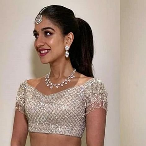 Radhika Merchant looks mesmerizing in a shimmery white lehenga