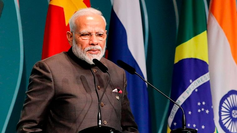 Prime Minister Narendra Modi speaks during the BRICS Business Council prior to the 11th edition of the BRICS Summit, in Brasilia.