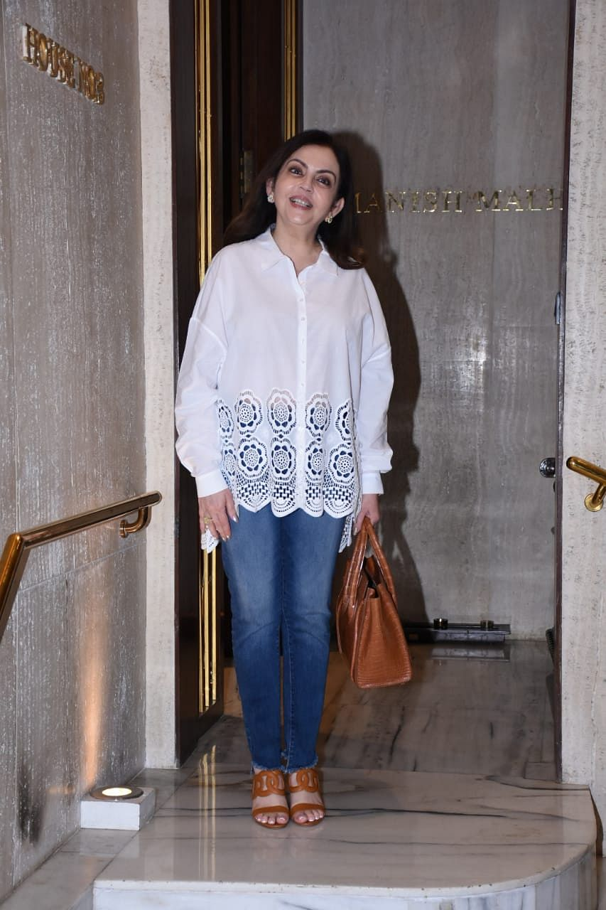 Nita Ambani keeps it simple yet stylish in a chic white shirt and blue jeans