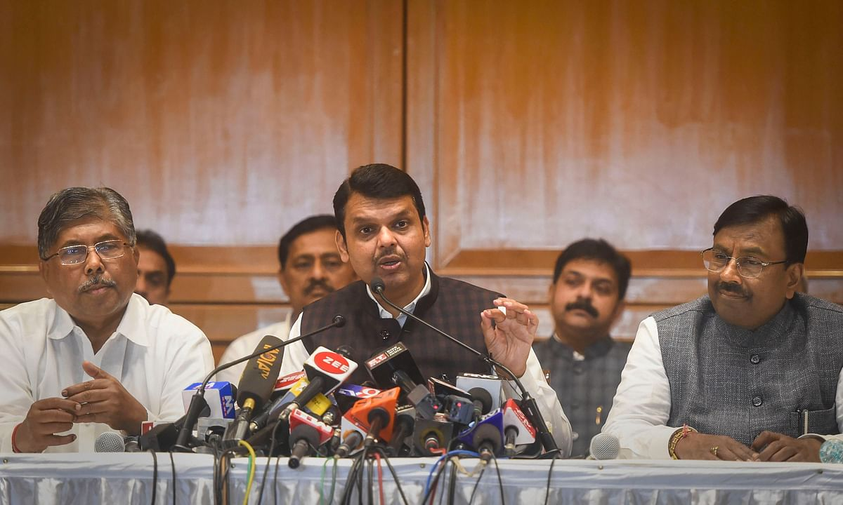 Devendra Fadnavis flanked by senior Bharatiya Janata Party (BJP) leader Sudhir Mungantiwar (L) and Maharashtra BJP president Chandrakant Patil (R), interacts with media personnel after his resignation from chief minister post, in Mumbai, Friday, Nov. 8, 2019.