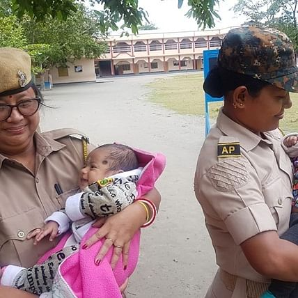 'We salute you': Twitter hails Assam police officers taking care of babies while their mothers write exam