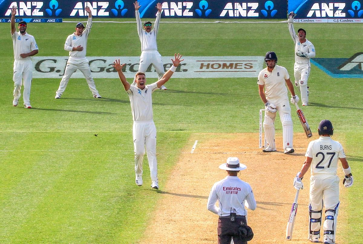 England's batsman Dom Sibley reacts as New Zealand's Tim Southee appeals successfully with team mates for LBW during the second day at Seddon Park in Hamilton on Saturday.