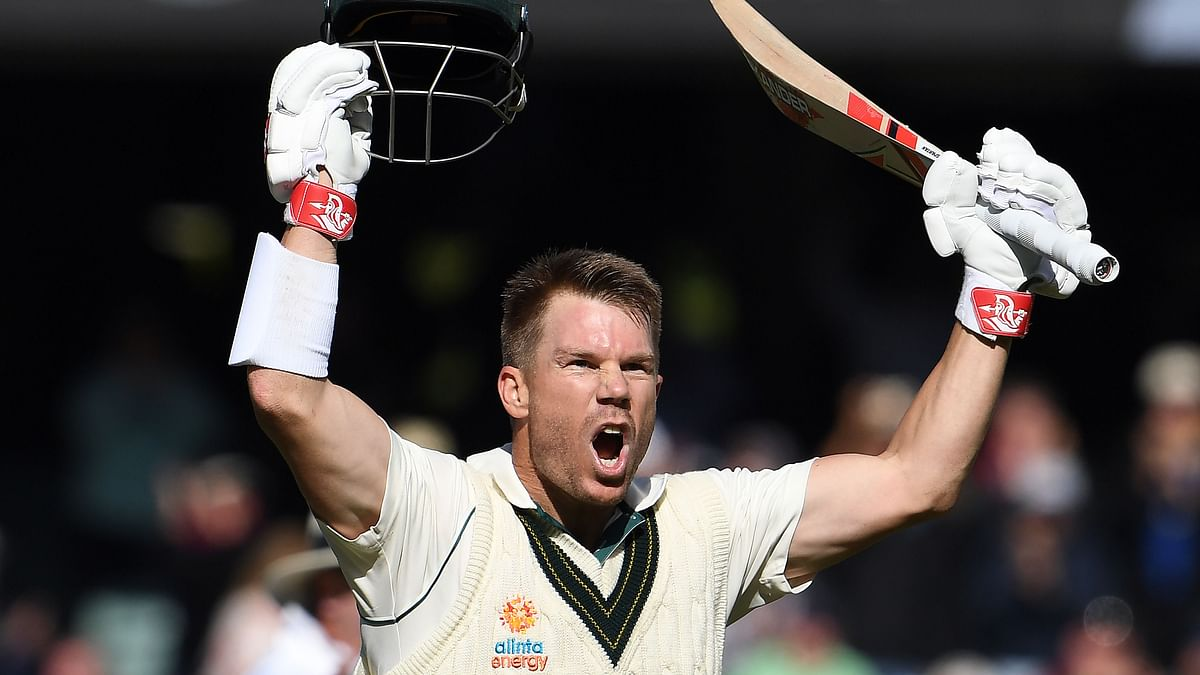 Australia's batsman David Warner celebrates reaching his triple century (300 runs) during the day two of the second cricket Test match between Australia and Pakistan in Adelaide on November 30, 2019.
