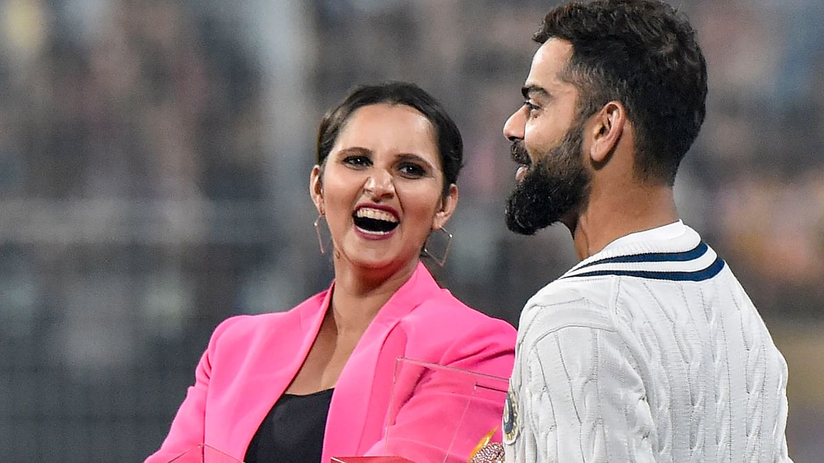 Indian cricket team Captain Virat Kohli shares a lighter moment with tennis player Sania Mirza after first day's play  of the 1st pink-ball day/night cricket test match between India and Bangladesh, at Eden Gardens .