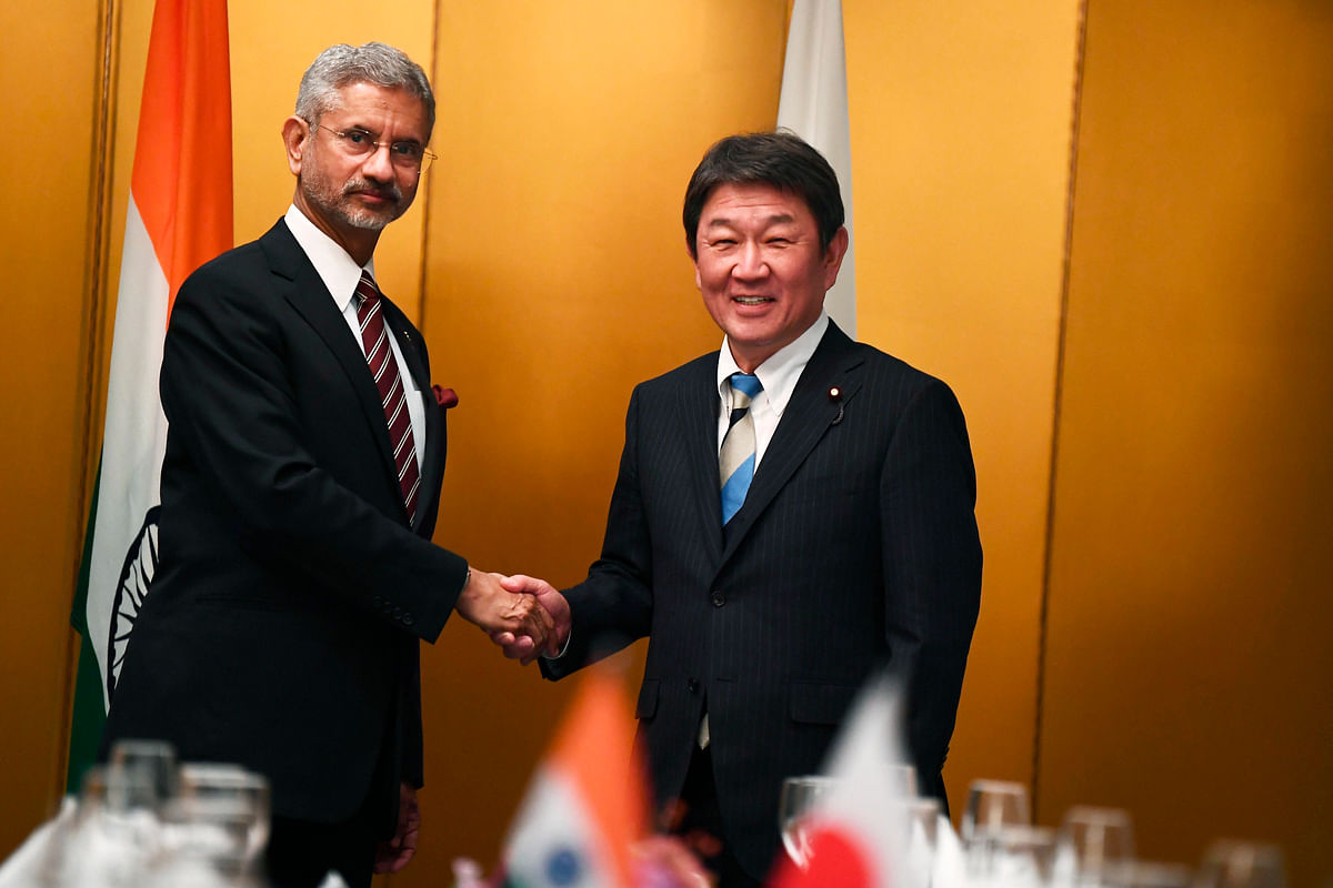 Japanese Foreign Minister Toshimitsu Motegi, right, poses with Indian Minister of External Affairs Subrahmanyam Jaishankar for photographers during a bilateral meeting ahead of the G20 Foreign Ministers' meeting in Nagoya, central Japan, Saturday, Nov. 23, 2019.