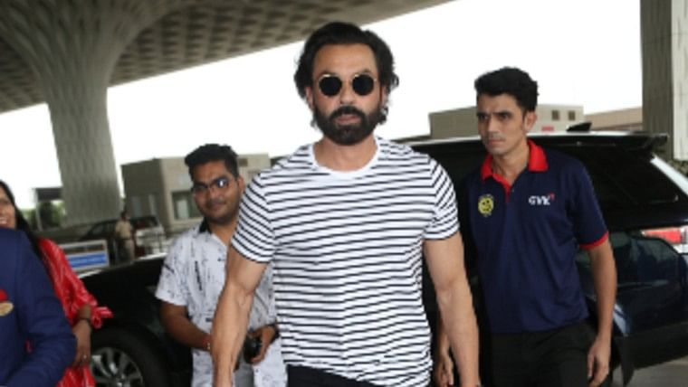 Touch feet and greet: Fan touches Bobby Deol's feet at the airport