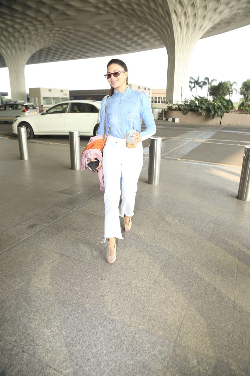 Airport Watch: Jacqueline Fernandez is slaying it in her cool denim shirt and white pants